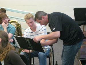 Dr. Fansler assists trumpeter Chris Haas