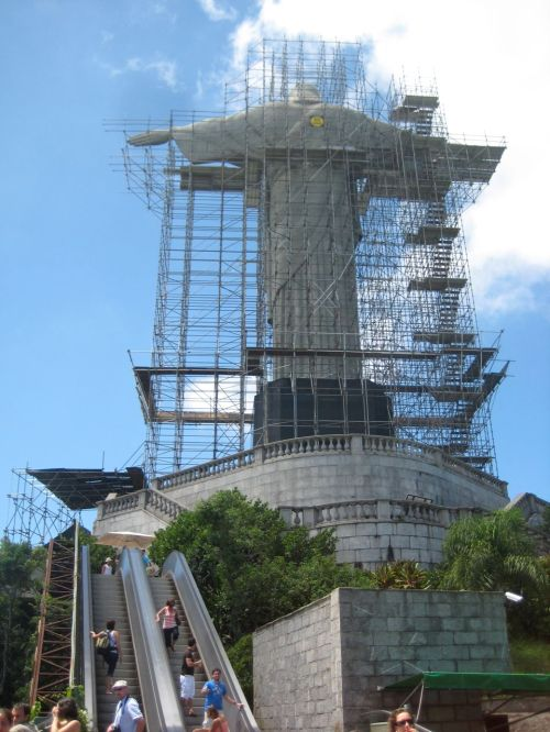Visitors utilize a train, elevators/stairs, and an escalator to access the nearly 80 year-old statue